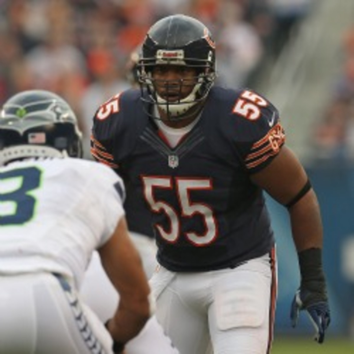 Bears linebacker Lance Briggs says Packers tight end Jermichael Finley should be quiet and called him an idiot. (Jonathan Daniel/Getty Images)