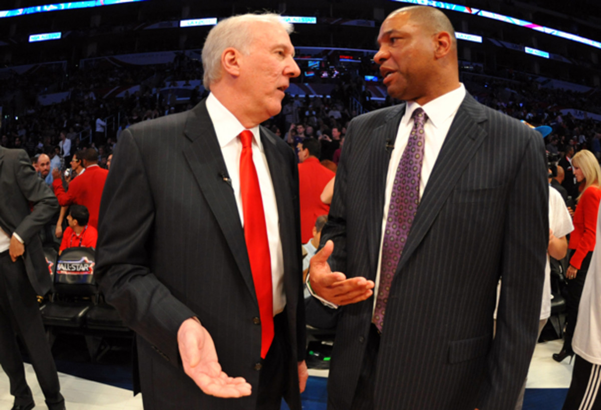 Doc Rivers, right, stood up for Gregg Popovich, left, on Friday. (Jesse D. Garrabrant/Getty Images)
