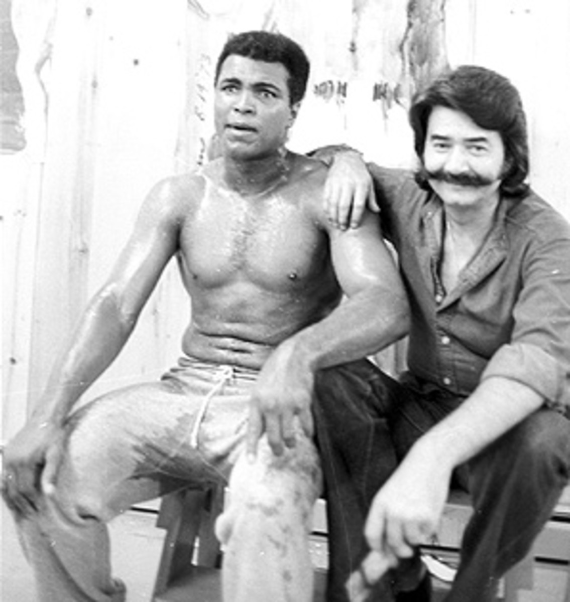 Celebrity sports artist Leroy Neiman is pictured with Muhammad Ali at his training camp cabin. Neiman passed away on June 20.