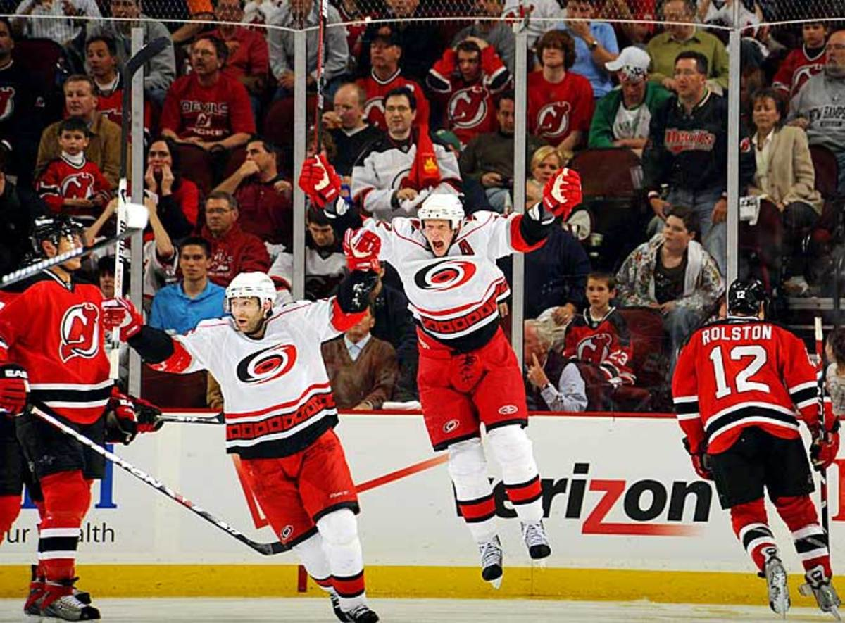 Erik Cole and Eric Staal celebrate in OT