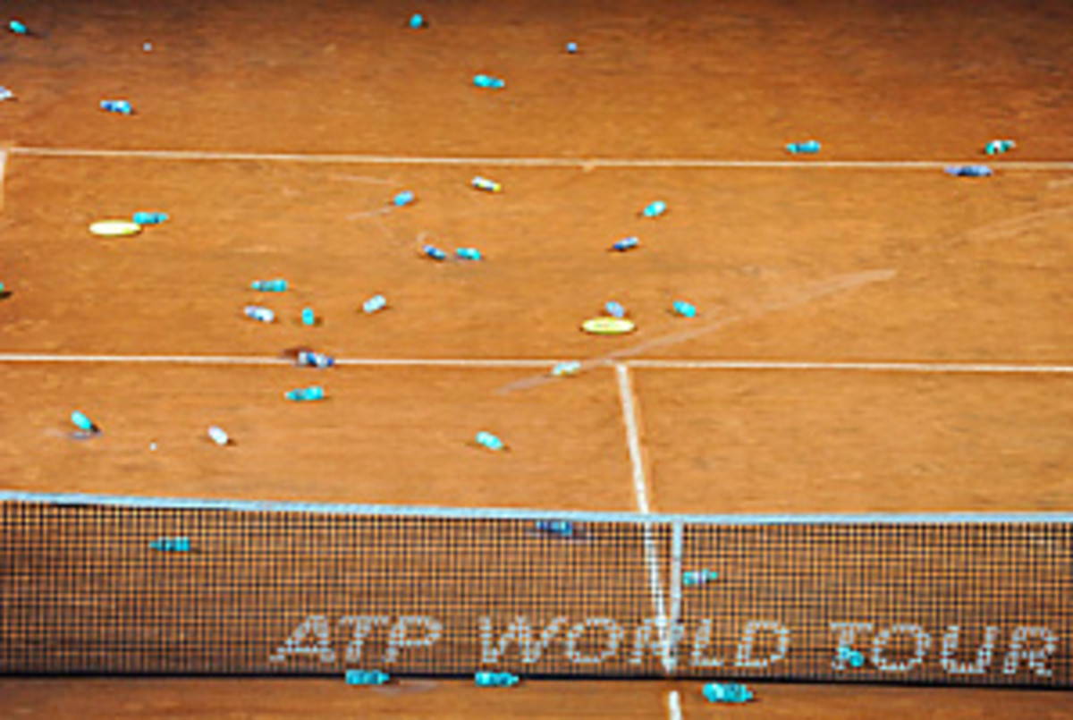 Fans threw bottles on Central Court after they heard the final was postponed.