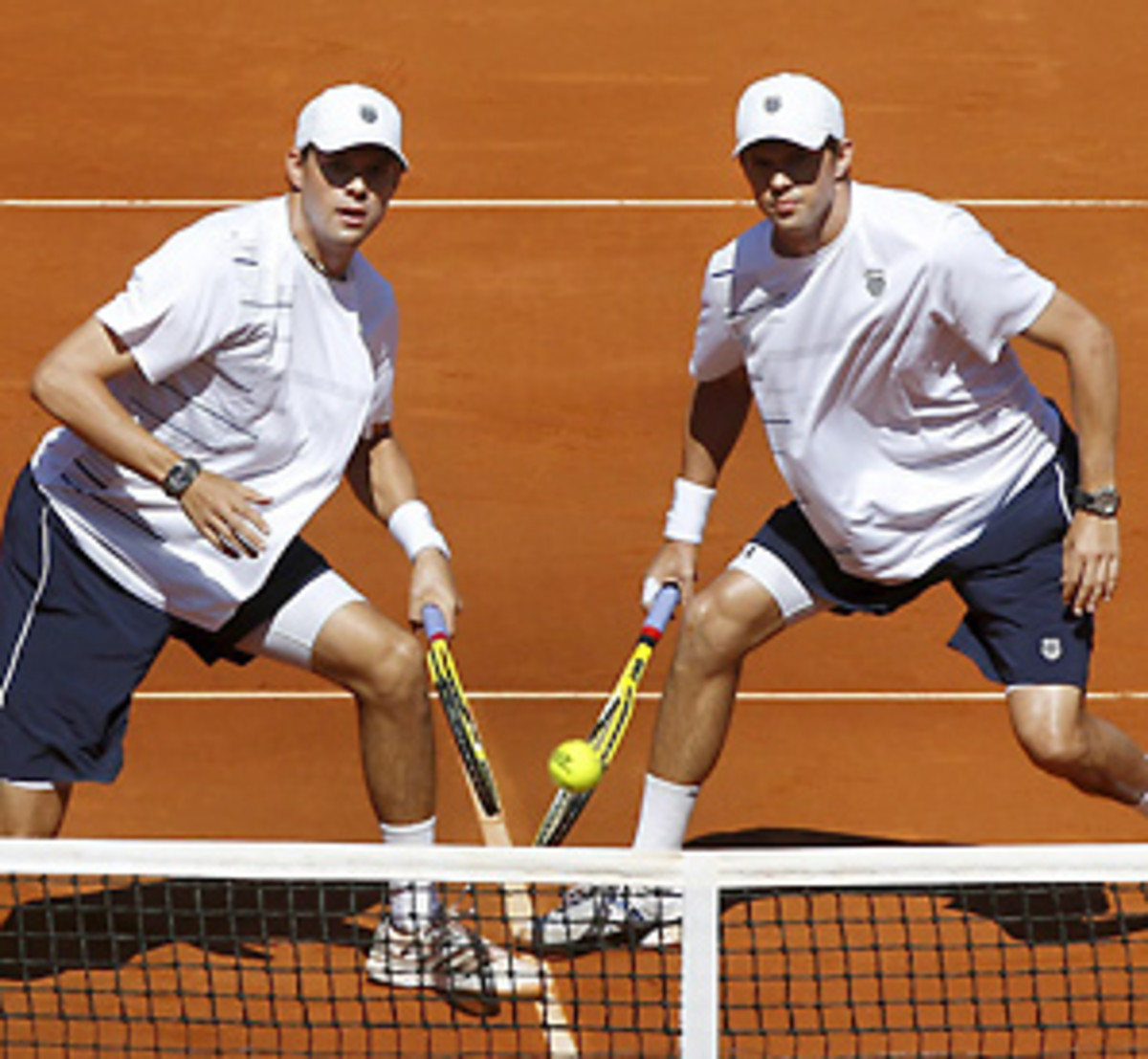 Bob (left) and Mike Bryan defeated Spain's Marcel Granollers and Marc Lopez on Saturday.