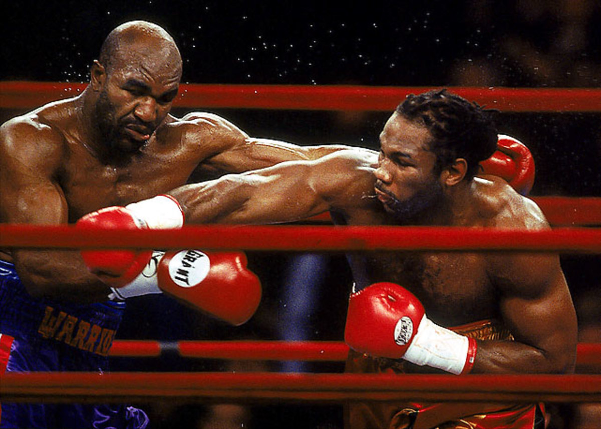 Evander Holyfield draw with Lennox Lewis