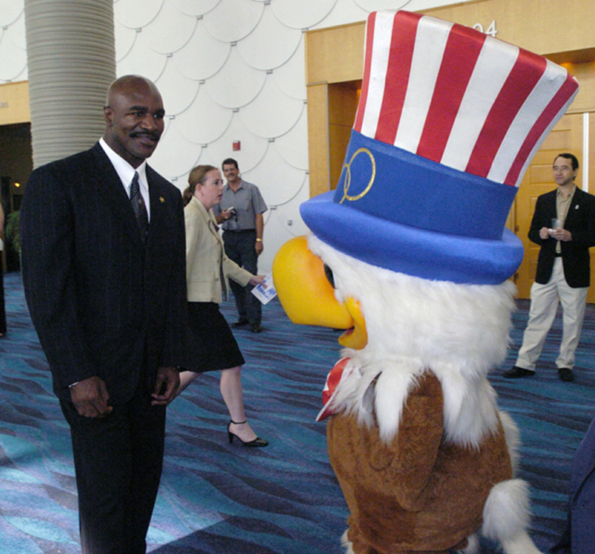 Evander Holyfield and Sam the Eagle