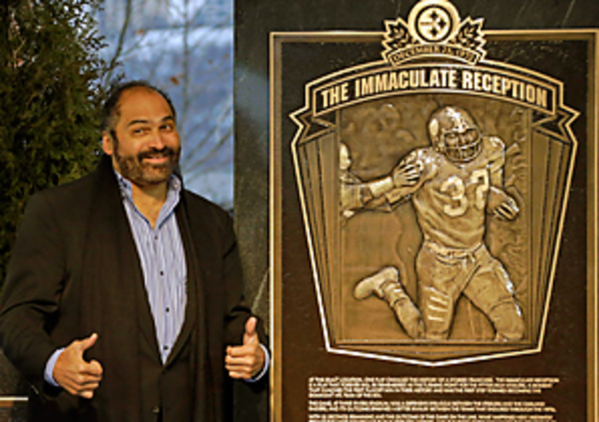 """Pittsburgh Steelers' Franco Harris stands on the spot of the """"Immaculate Reception"""" after a marker commemorating the 40th anniversary of the play was unveiled."""