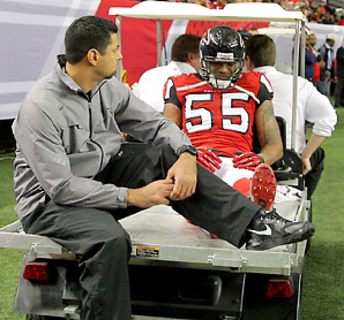 The Falcons defense will have a hard time in the divisional round if it has to play without John Abraham. (Todd Kirkland/Icon SMI)