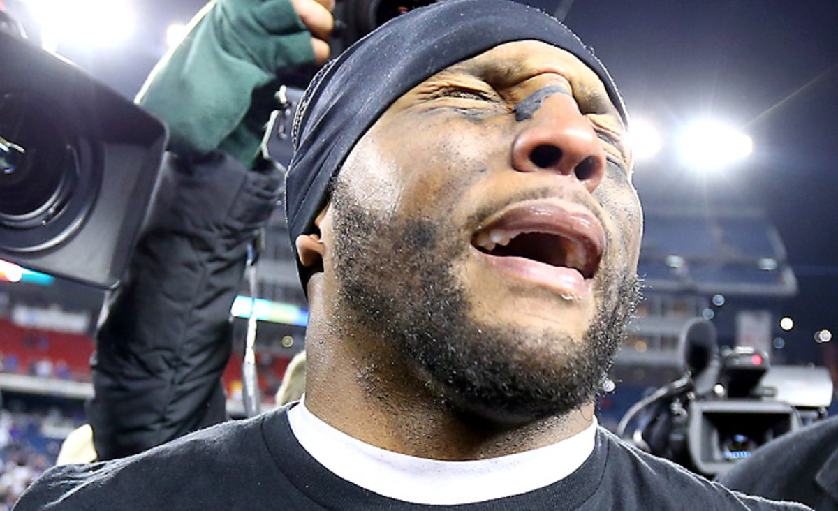 Ray Lewis was overcome with emotion after the Ravens' upset the Patriots to keep his retirement tour alive.