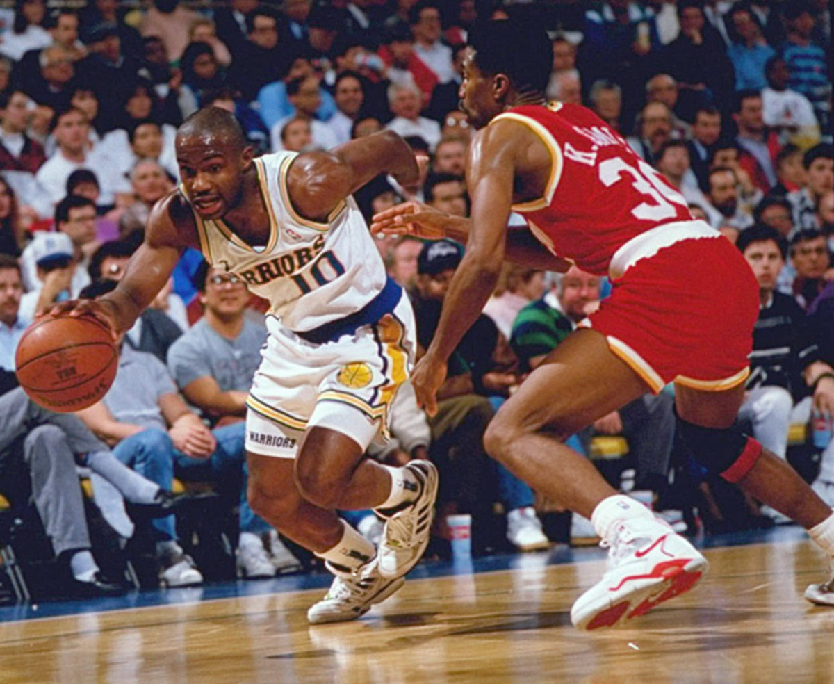 Tim Hardaway blows by Kenny Smith during a 1991 Warriors-Rockets game. (Peter Read Miller/SI)
