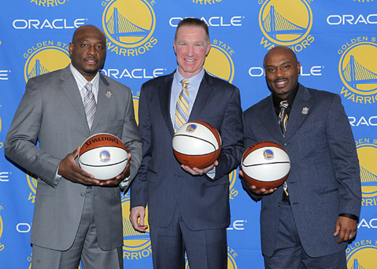 Richmond, Mullin and Hardaway pose at Mullin's jersey retirement ceremony last March. ( Rocky Widner/NBAE via Getty Images)