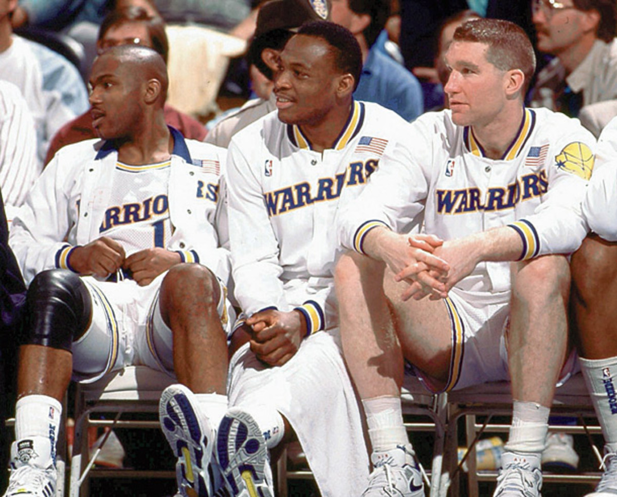 Tim Hardaway, Mitch Richmond and Chris Mullin take a rest during a 1989 Warriors game. (NBA Photos/Getty Images)