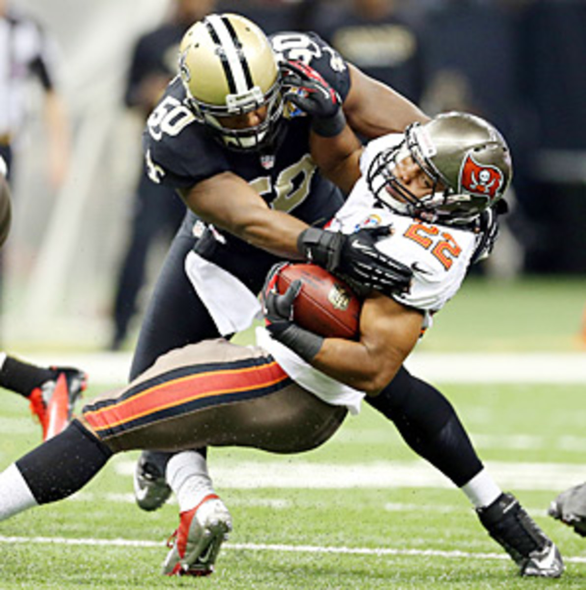 Doug Martin (22) carried the ball a measly nine times for 16 yards against the Saints.