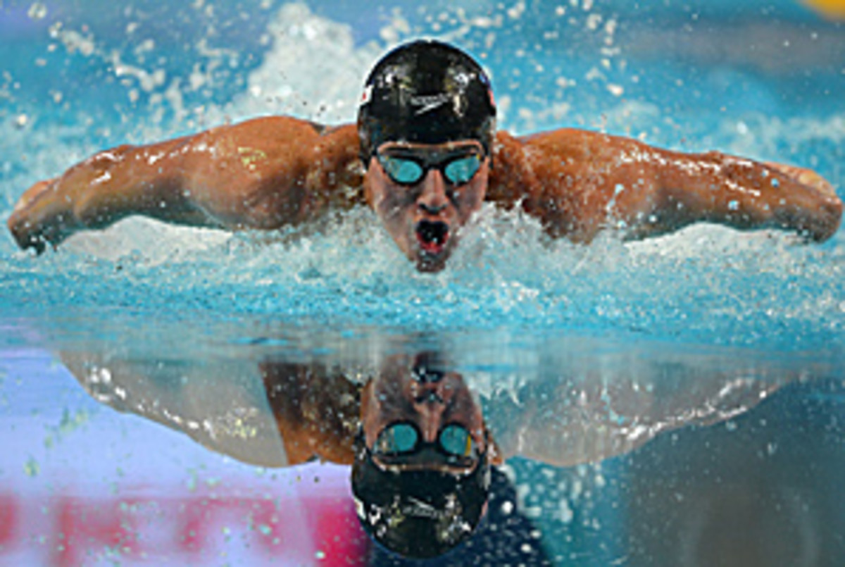 Lochte broke the world record in the 100-meter individual medley, finishing in 51.21 seconds, ahead of Kenneth To and George Bovell.