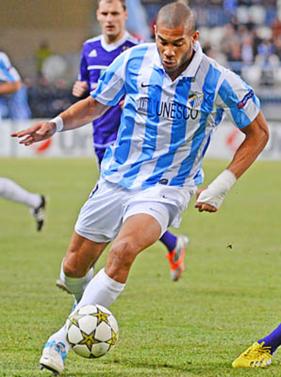 American Oguchi Onyewu plays for Malaga, which advanced into the Champions League knockout stages.