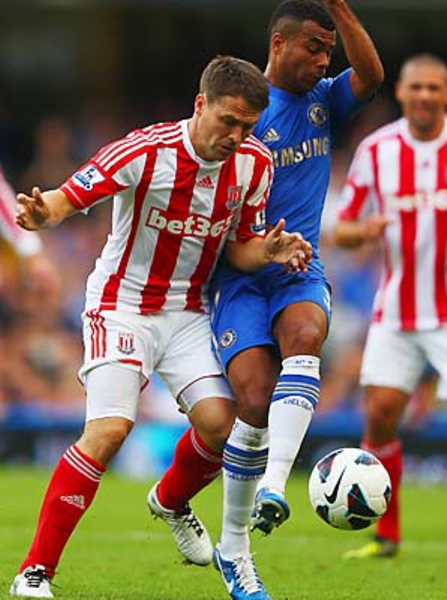 Michael Owen battles with Chelsea's Ashley Cole in a September Premier League match.