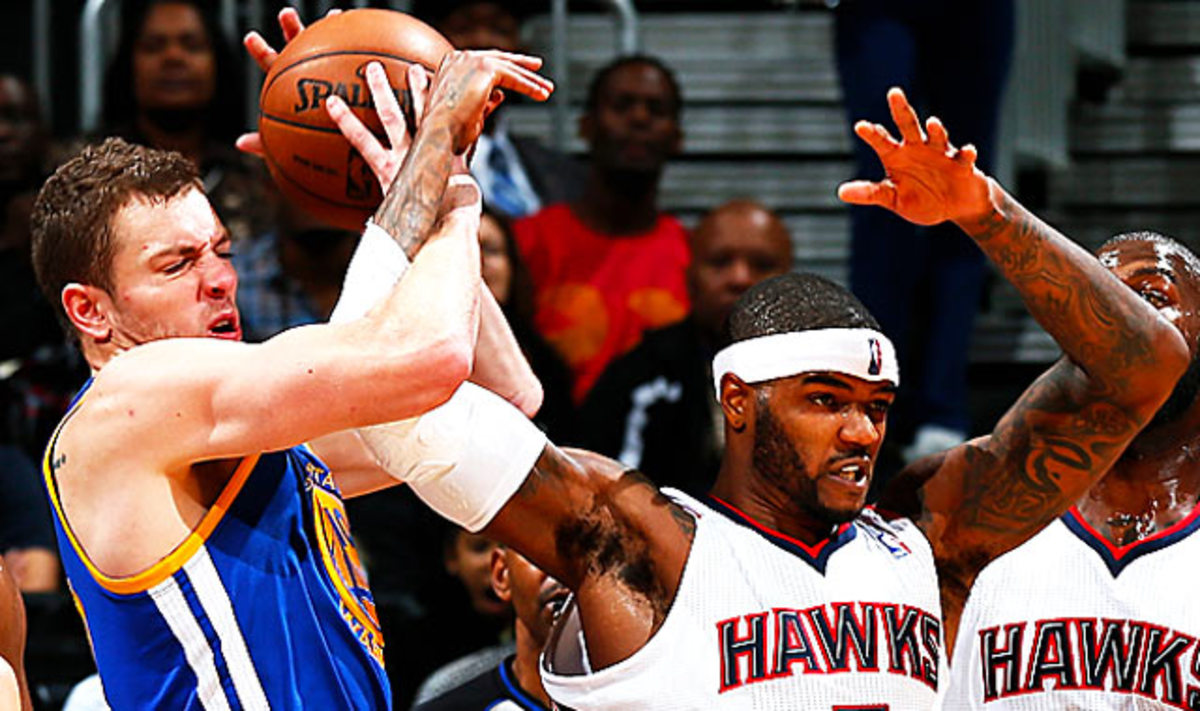 Lee (left) is fifth in the NBA with 11.5 rebounds per game. (Kevin C. Cox/Getty Images)