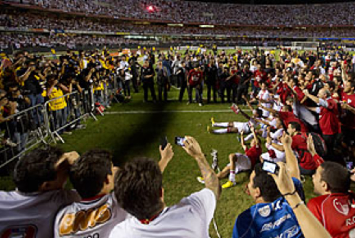 Sao Paulo poses for pictures as they celebrate at the end of the Copa Sudamericana final.