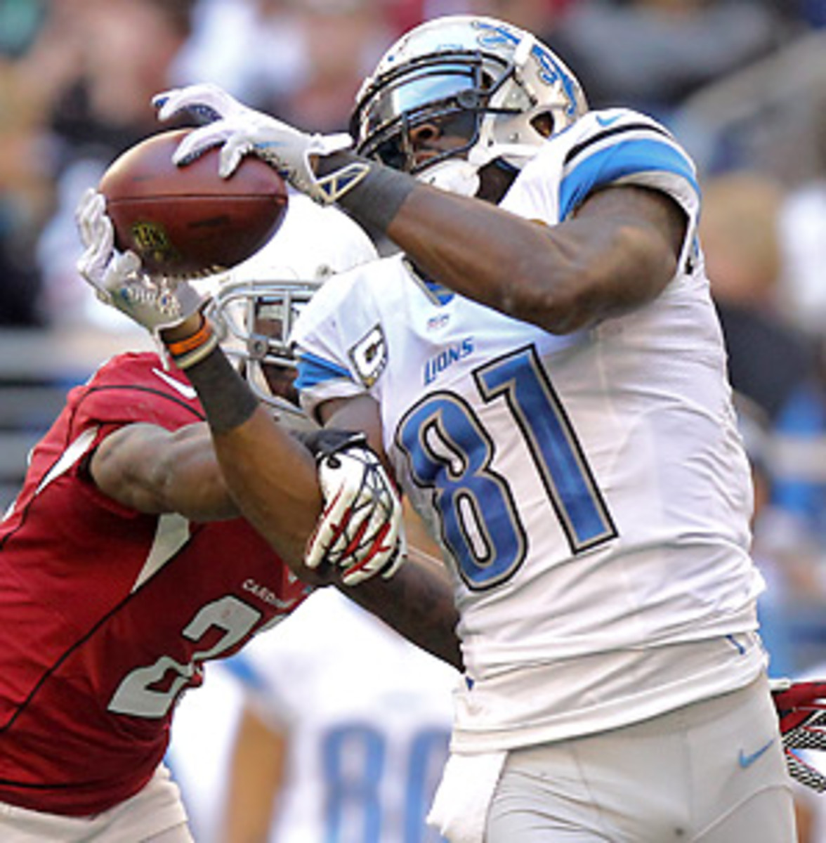 While Adrian Peterson shoots for the single-season rushing record, Calvin Johnson is close to taking down Jerry Rice. (Paul Connors/AP)