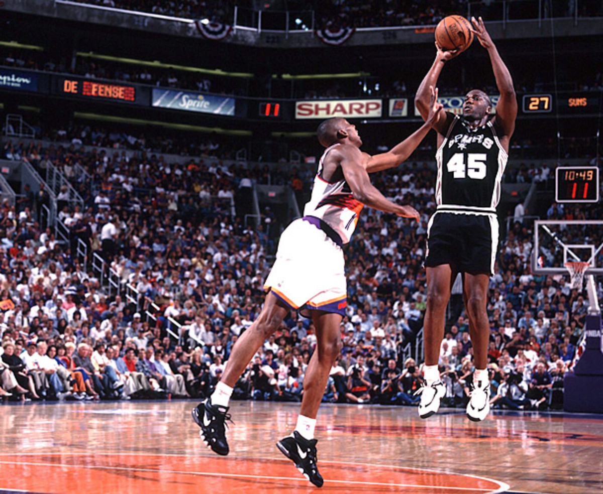 Chuck Person shoots over his brother, Wesley, during a  1996 Spurs-Suns game. (John W. McDonough/SI)