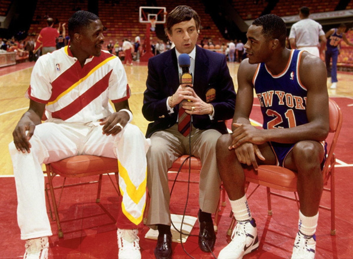 Dominique and Gerald Wilkins with Marv Albert in 1987. (Andrew D. Bernstein/NBAE via Getty Images)