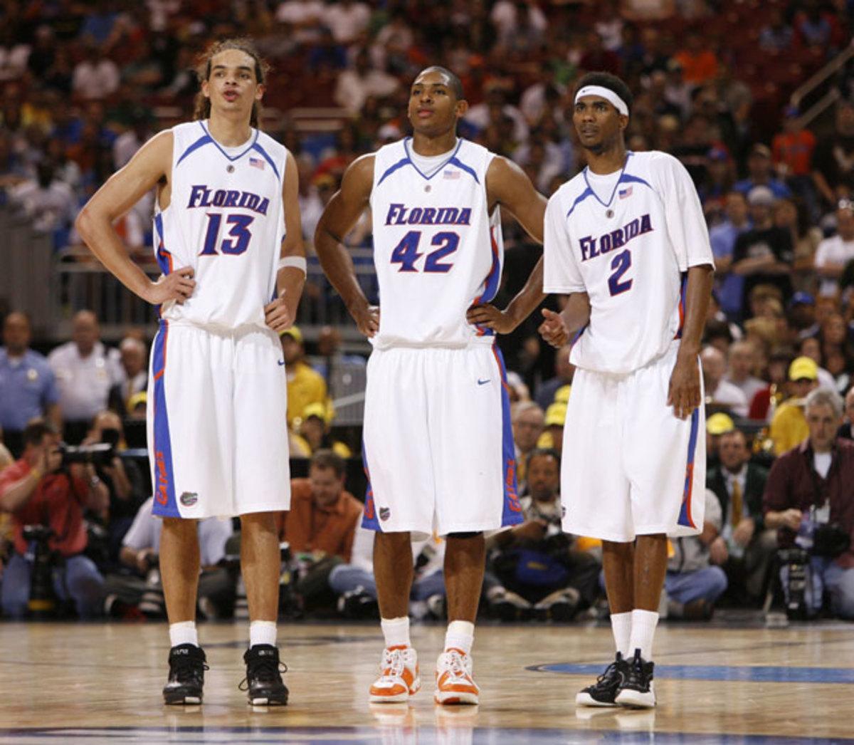 Joakim Noah,  Al Horford and Corey Brewer