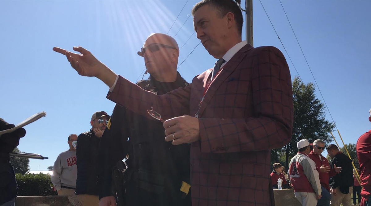 Alabama athletic director Greg Byrne speaks to a police officer ahead of Alabama's game against LSU. U.S. president Donald Trump's visit to Tuscaloosa went off without a hitch.