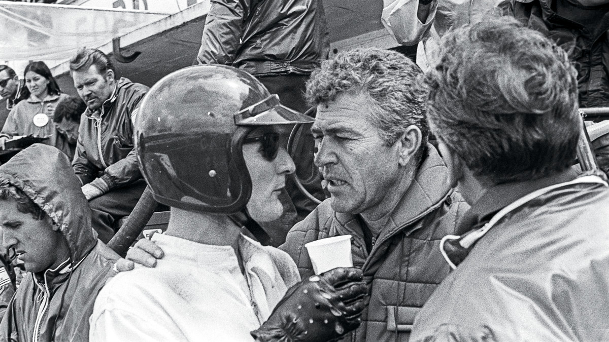 Ken Miles (left) confers with Carroll Shelby during the 1966 race. (Bernard Cahier/Getty Images)