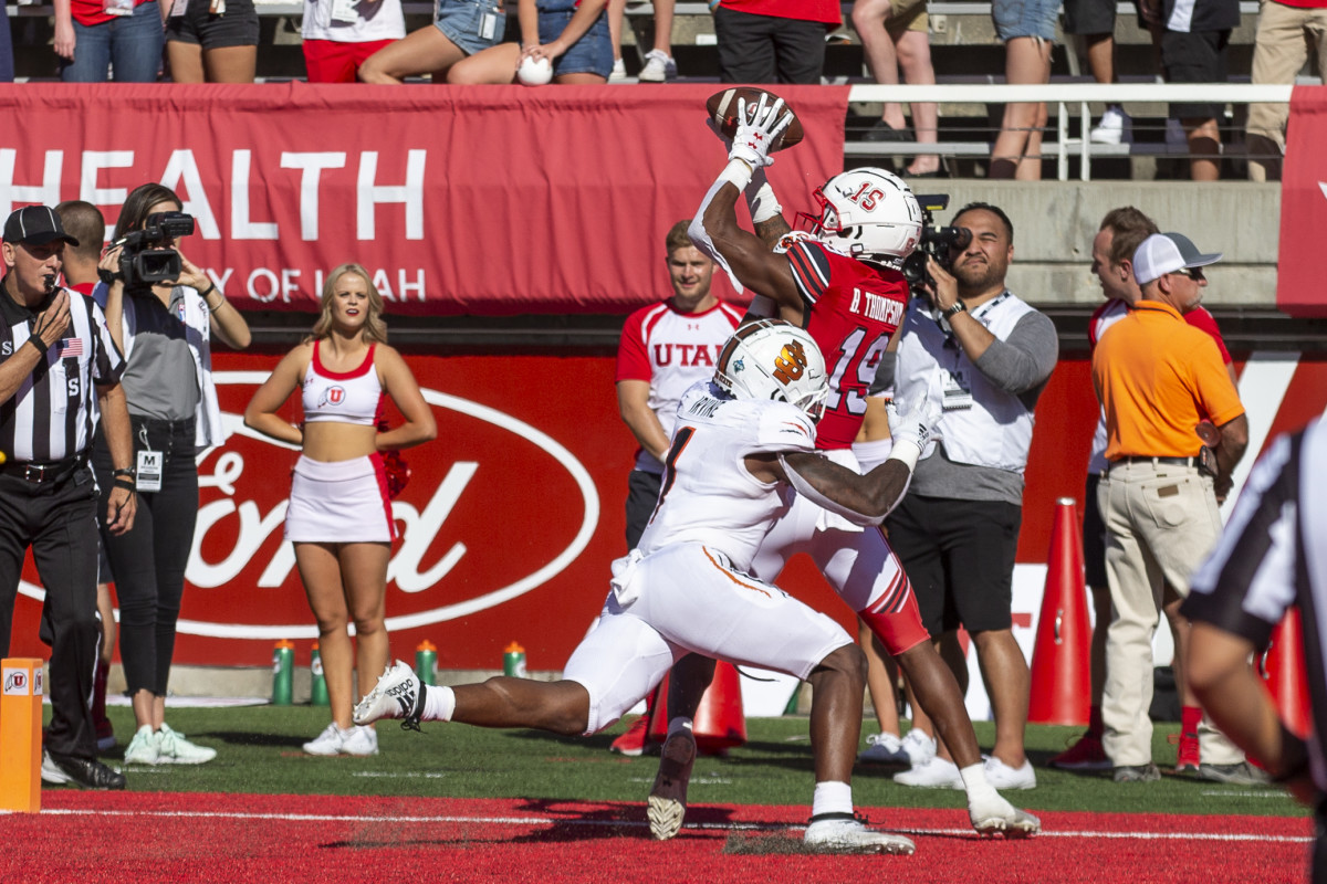 Sep 14, 2019; Salt Lake City, UT, USA; Utah Utes wide receiver Bryan Thompson (19) catches a touchdown pass while defended by Idaho State Bengals defensive back Jay Irvine (1) during the second half at Rice-Eccles Stadium.