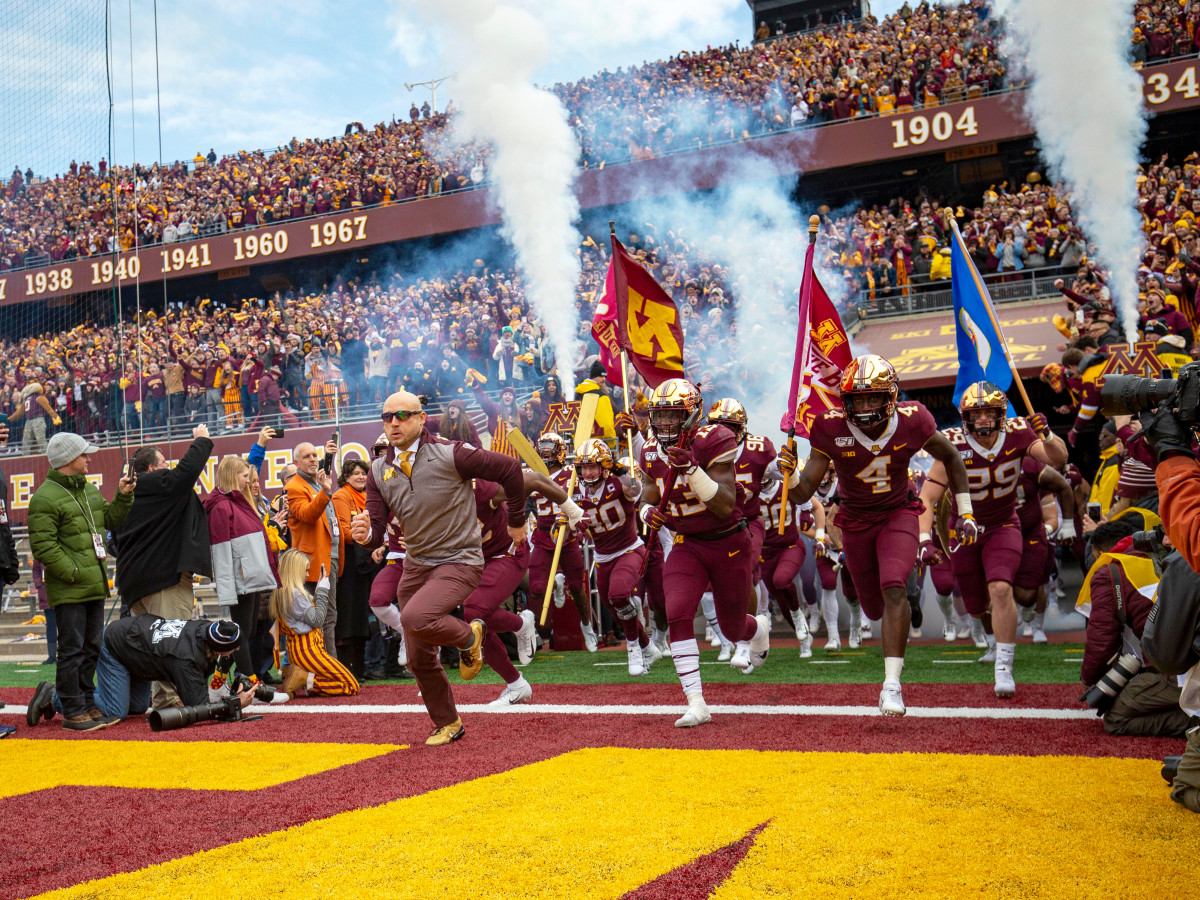 Nov 9, 2019; Minneapolis, MN, USA; Minnesota Golden Gophers head coach P.J. Fleck leads the Minnesota Golden Gophers onto the field before a game against the Penn State Nittany Lions at TCF Bank Stadium. Mandatory Credit: Jesse Johnson-USA TODAY Sports