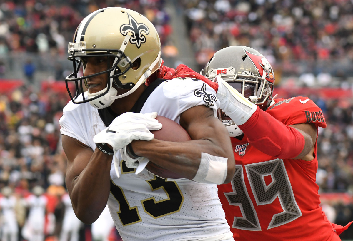 Nov 17, 2019; Tampa, FL, USA; New Orleans Saints wide receiver Michael Thomas (13) is tackled by Tampa Bay Buccaneers defensive back Andrew Adams (39) in the second half at Raymond James Stadium. Mandatory Credit: Jonathan Dyer-USA TODAY Sports