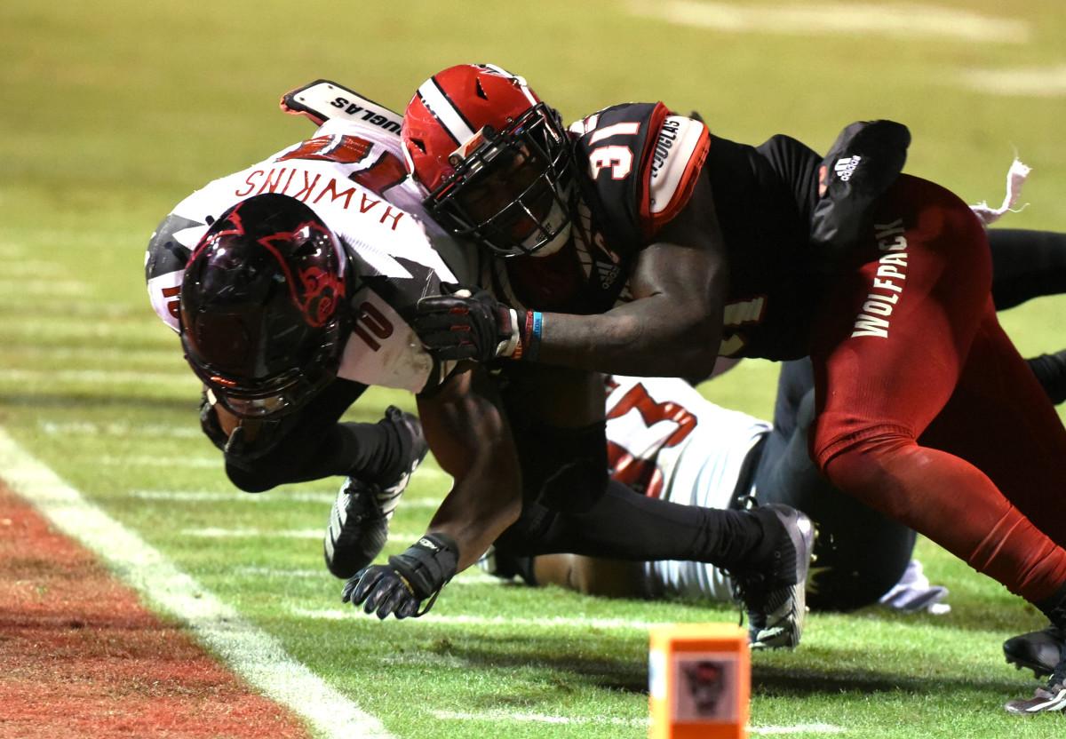 Jarius Morehead makes a tackle against Louisville earlier this season