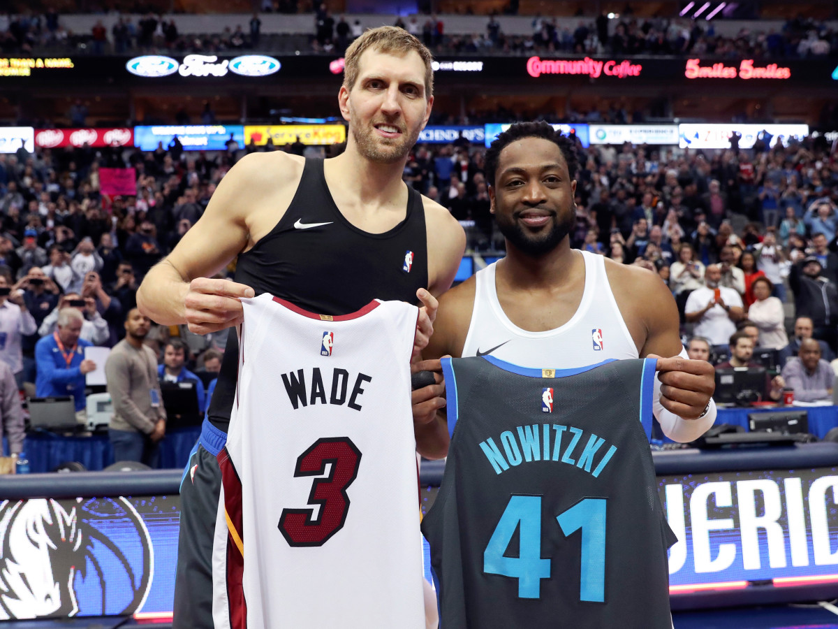 Feb 13, 2019; Dallas, TX, USA; Dallas Mavericks forward Dirk Nowitzki (left) and Miami Heat guard Dwyane Wade (right) exchange jerseys after the game at American Airlines Center. Mandatory Credit: Kevin Jairaj-USA TODAY Sports