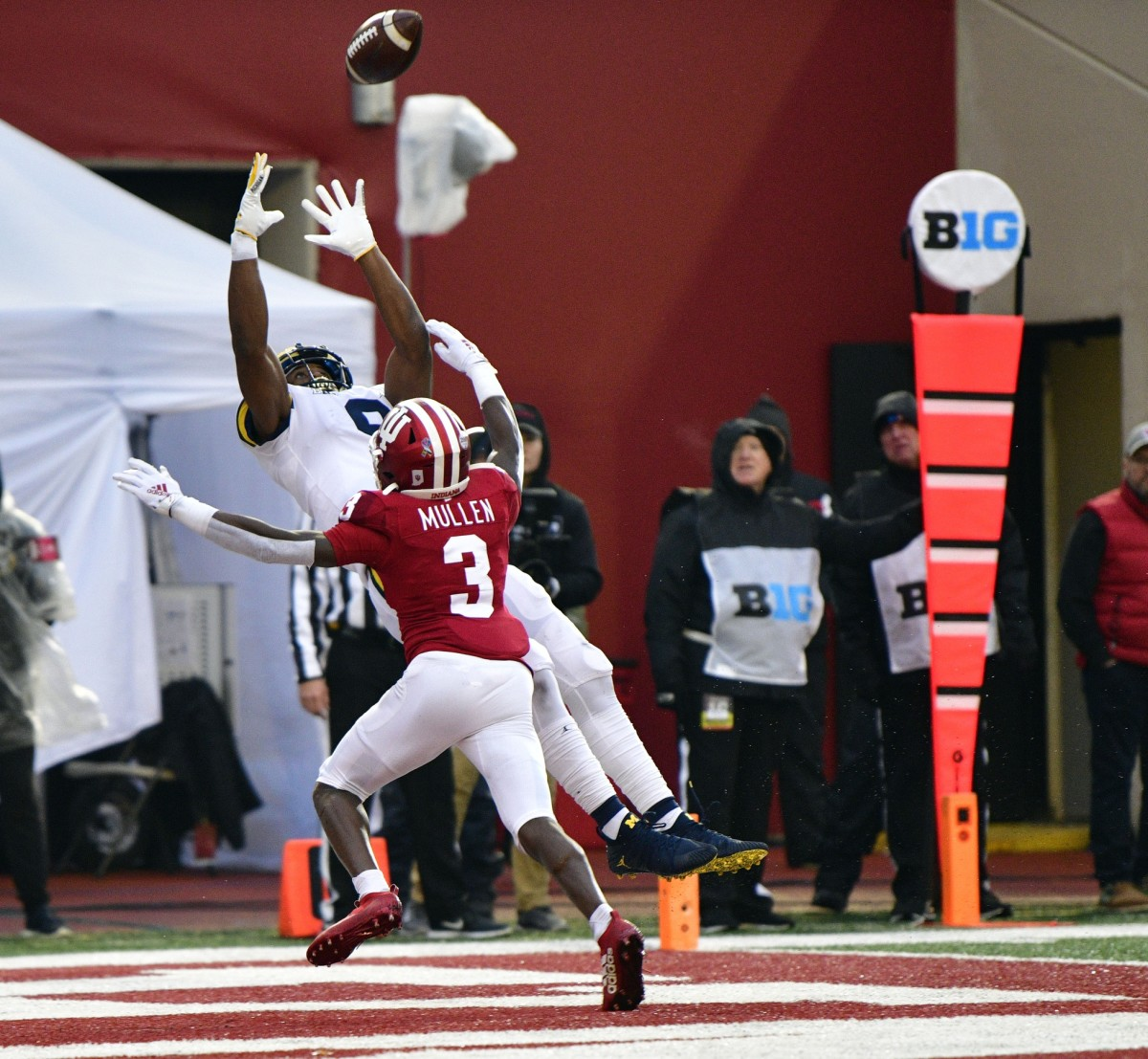 Michigan Wolverines wide receiver Donovan Peoples-Jones (9) catches a ball for a touchdown under coverage from Indiana Hoosiers defensive back Tiawan Mullen (3) during the first half of the game at Memorial Stadium . Mandatory Credit: Marc Lebryk-USA TODAY Sports