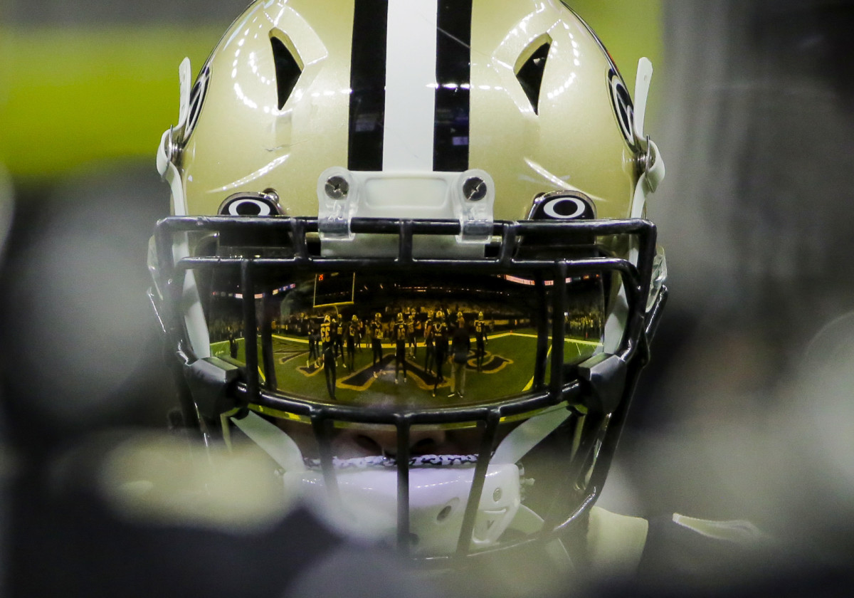 Nov 24, 2019; New Orleans, LA, USA; A reflection of players huddling is seen on the visor of New Orleans Saints running back Alvin Kamara (41) prior to kickoff against the Carolina Panthers at the Mercedes-Benz Superdome. Mandatory Credit: Derick E. Hingle-USA TODAY Sports