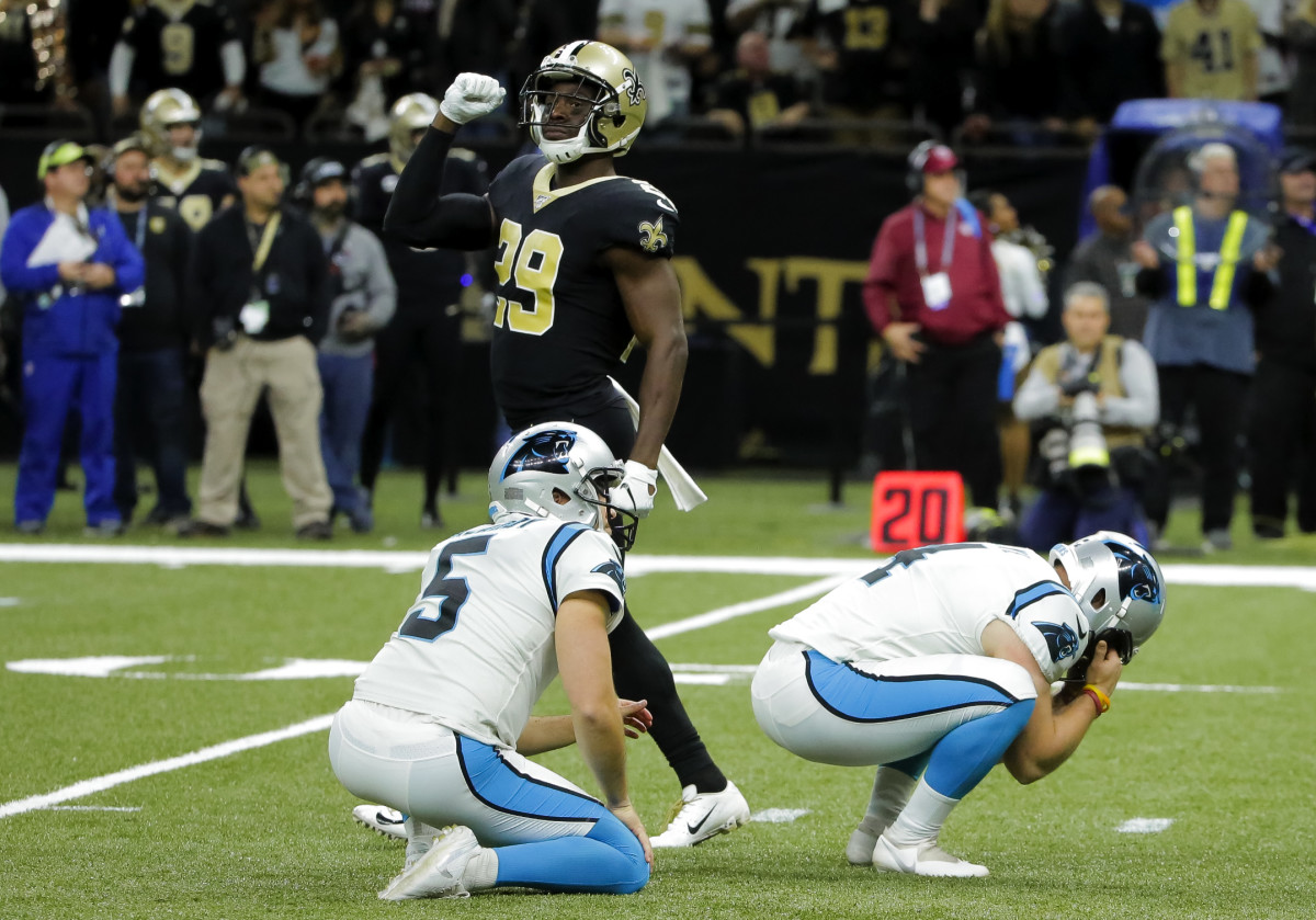 Nov 24, 2019; New Orleans, LA, USA; New Orleans Saints defensive back Johnson Bademosi (29) celebrates as Carolina Panthers kicker Joey Slye (4) reacts to missing a field goal during the fourth quarter at the Mercedes-Benz Superdome. Mandatory Credit: Derick E. Hingle-USA TODAY Sports
