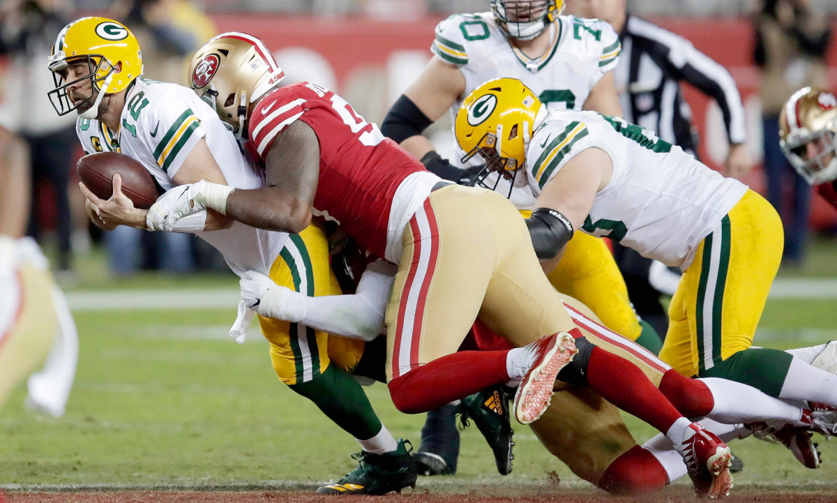 Buckner and his Niners teammates dropped Rodgers five times.
