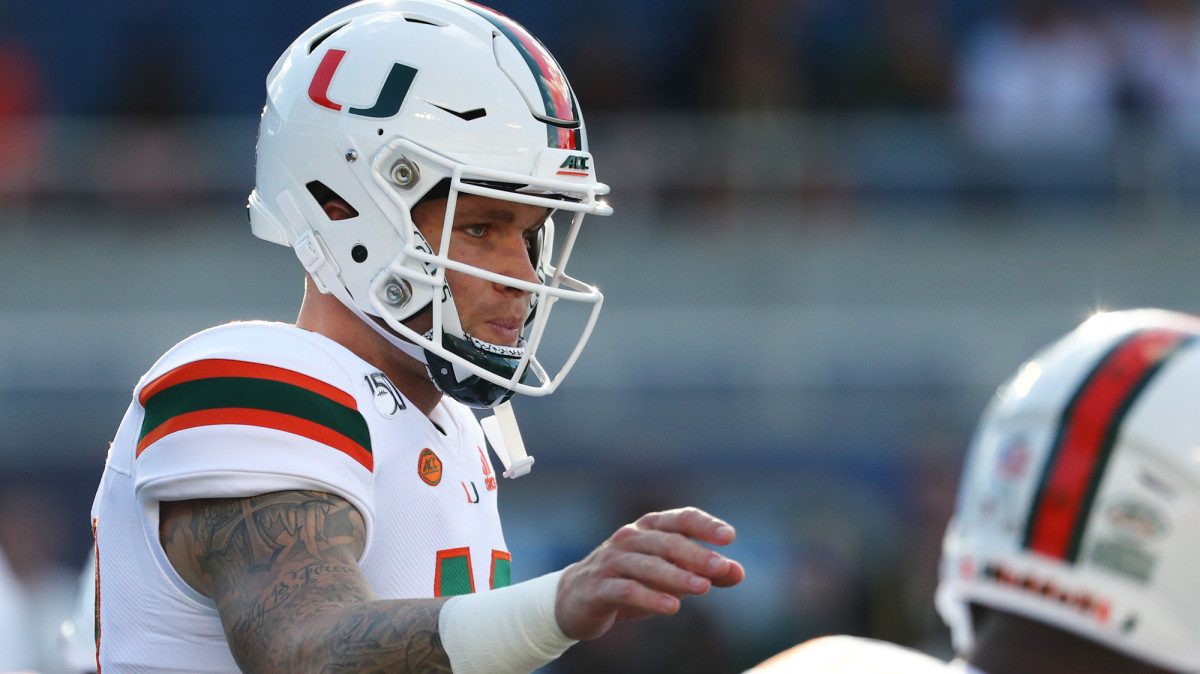 Miami QB Tate Martell works out prior to the game at Camping World Stadium.