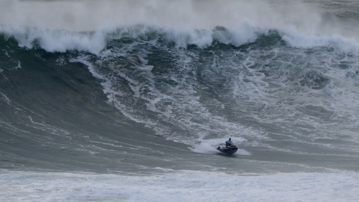 """Surfer Lucas """"Chumbo"""" Chianca is rescued from a wave off the coast of Nazaré, Portugal"""
