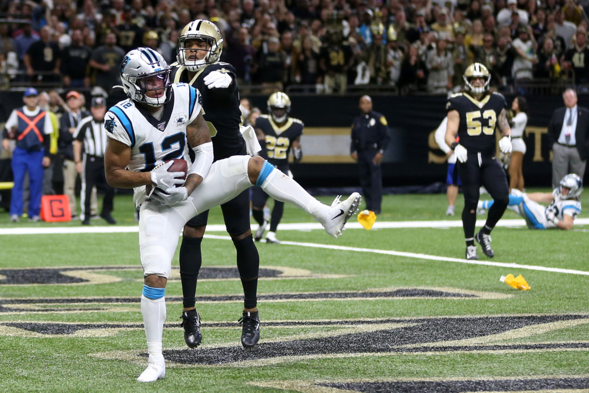 Nov 24, 2019; New Orleans, LA, USA; Carolina Panthers wide receiver D.J. Moore (12) makes a touchdown catch while defended by New Orleans Saints cornerback P.J. Williams (26) in the second half at the Mercedes-Benz Superdome. The Saints won, 34-31. Mandatory Credit: Chuck Cook-USA TODAY Spor