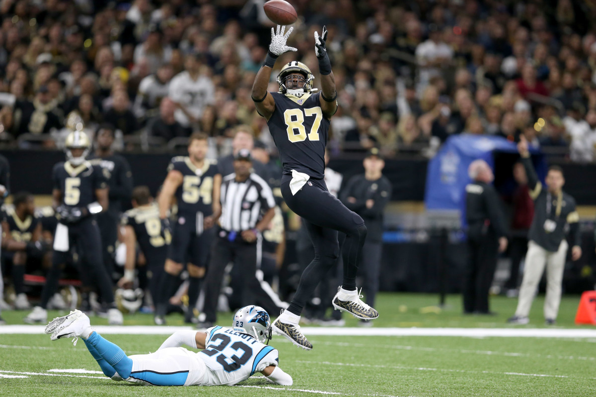 Nov 24, 2019; New Orleans, LA, USA; New Orleans Saints tight end Jared Cook (87) makes a catch with Carolina Panthers cornerback Javien Elliott (23) defending in the first quarter at the Mercedes-Benz Superdome. Cook was flagged for offensive pass interference. Mandatory Credit: Chuck Cook-USA TODAY Sports