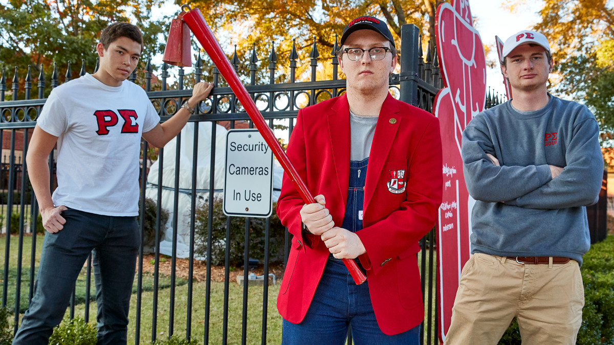Roberson and Rho Sigma at the ready, with their Reddies stick.