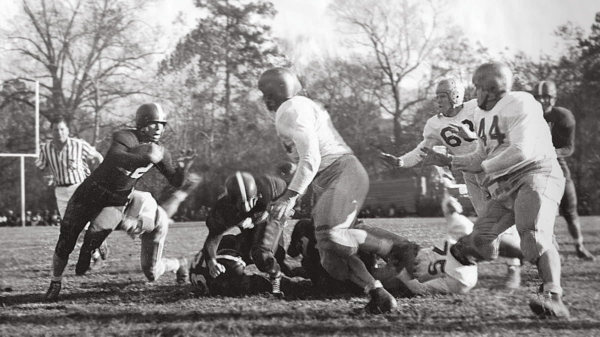 Henderson carrying against Ouachita in 1950.