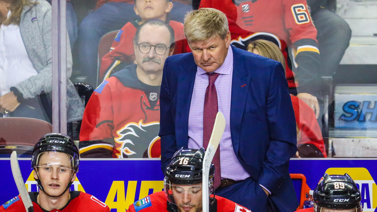Flames coach Bill Peters on the bench