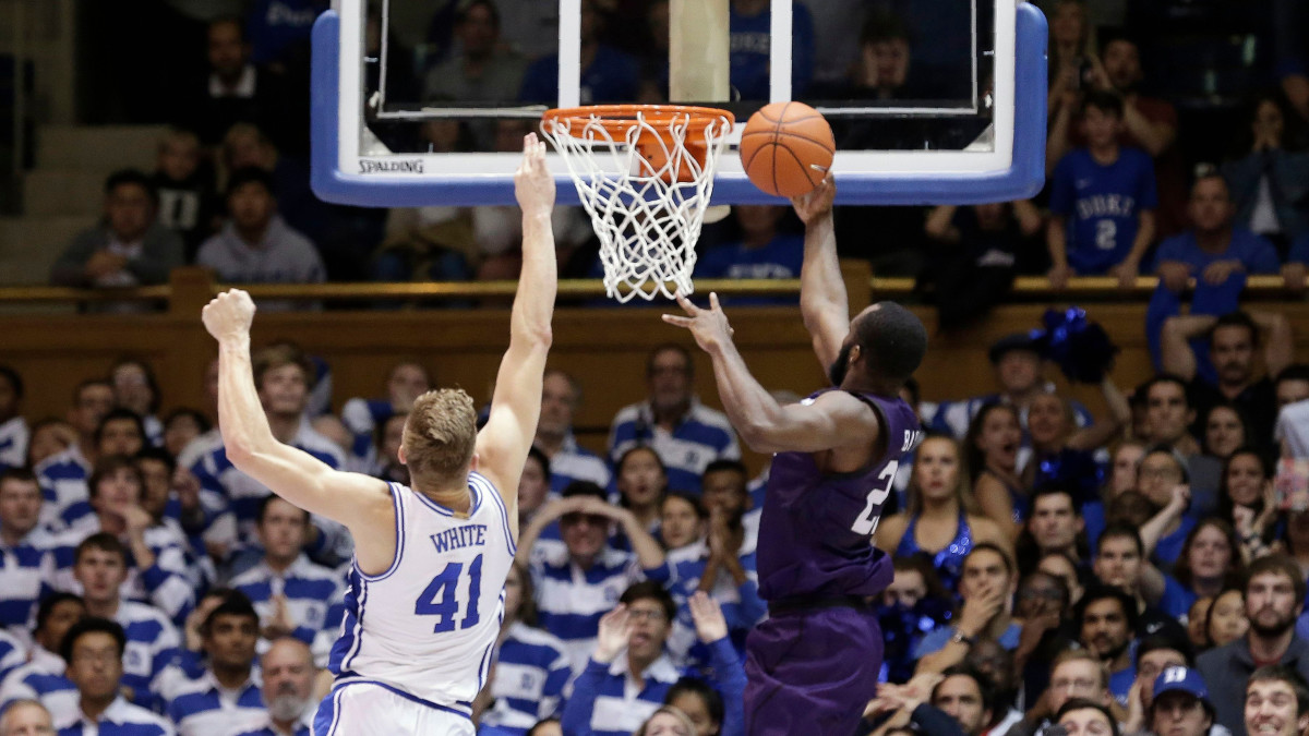 Stephen F. Austin's Nathan Bate makes the game-winning layup against Duke.