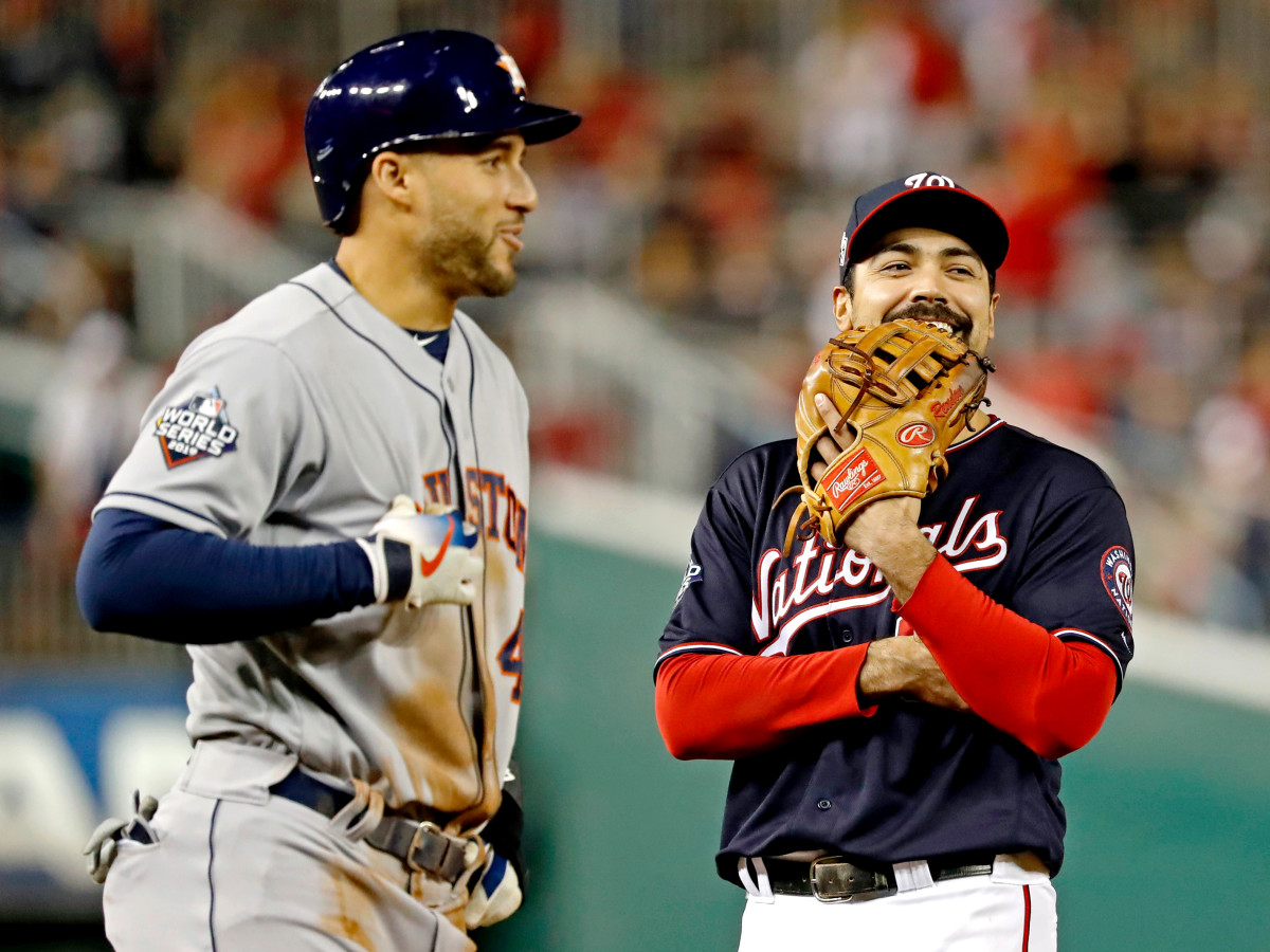Oct 27, 2019; Washington, DC, USA; Washington Nationals third baseman Anthony Rendon (6) and Houston Astros center fielder George Springer (4) talk during the eighth inning in game five of the 2019 World Series at Nationals Park. Mandatory Credit: Geoff Burke-USA TODAY Sports