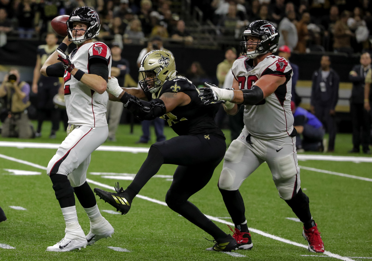 Nov 10, 2019; New Orleans, LA, USA; Atlanta Falcons quarterback Matt Ryan (2) throws for a touchdown against New Orleans Saints defensive end Marcus Davenport (92) during the fourth quarter at the Mercedes-Benz Superdome. Mandatory Credit: Derick E. Hingle-USA TODAY Sports
