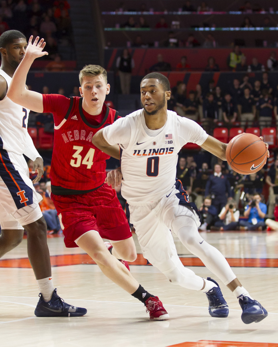 Illinois guard Alan Griffin (0) drives to the basket defended by Nebraska guard Thorir Thorbjarnarson (34) during the first half at State Farm Center.