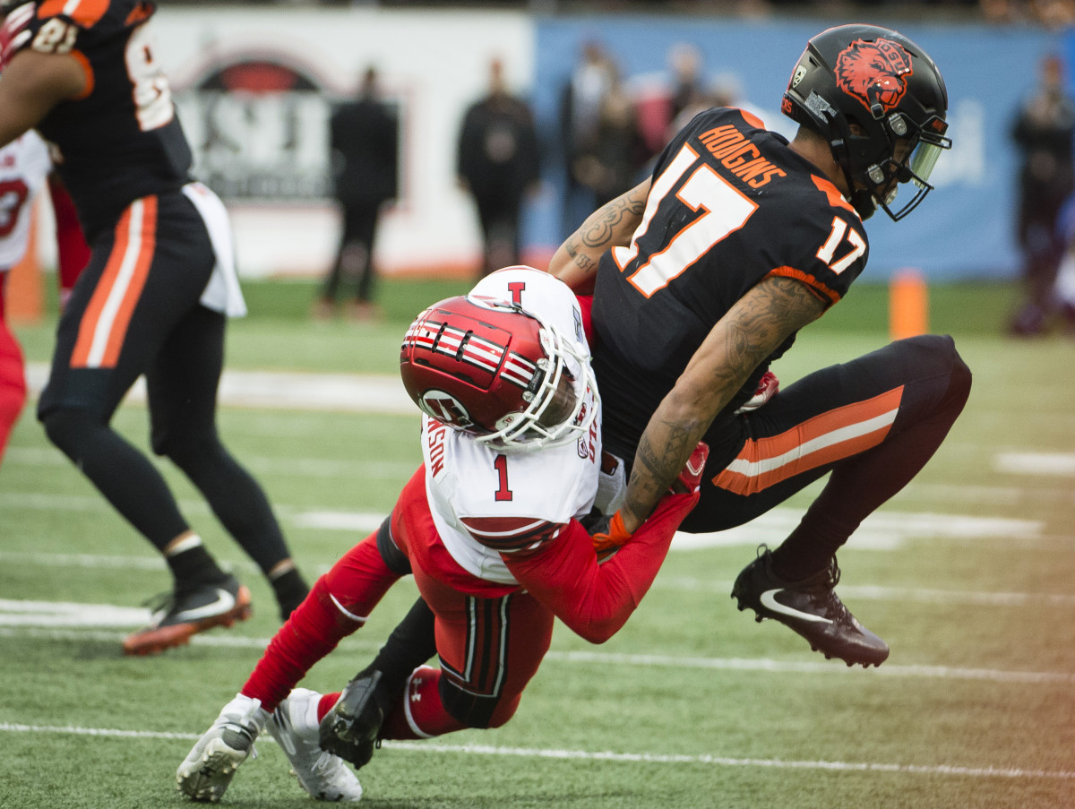 Oct 12, 2019; Corvallis, OR, USA; Oregon State Beavers wide receiver Isaiah Hodgins (17) is tackled on a pass play by Utah Utes defensive back Jaylon Johnson (1) during the first half at Reser Stadium. Mandatory Credit: Troy Wayrynen-USA TODAY Sports
