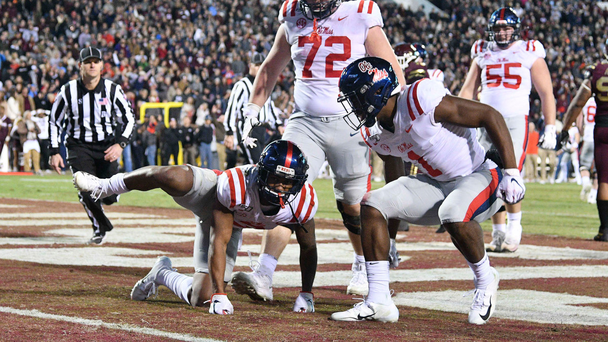 Ole Miss dog peeing celebration Egg Bowl