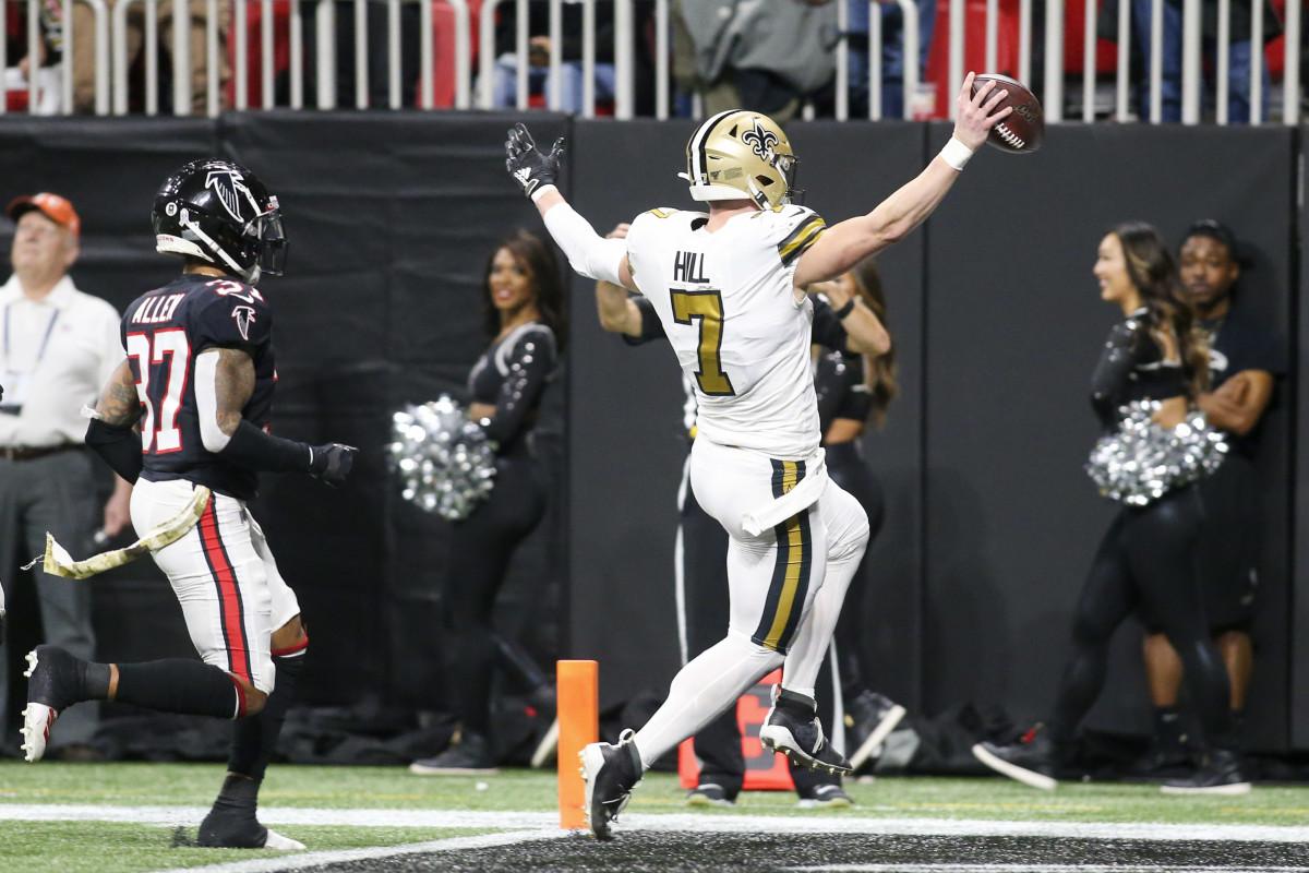 Nov 28, 2019; Atlanta, GA, USA; New Orleans Saints quarterback Taysom Hill (7) scores a touchdown in front of Atlanta Falcons free safety Ricardo Allen (37) in the first half at Mercedes-Benz Stadium. Mandatory Credit: Brett Davis-USA TODAY Sports