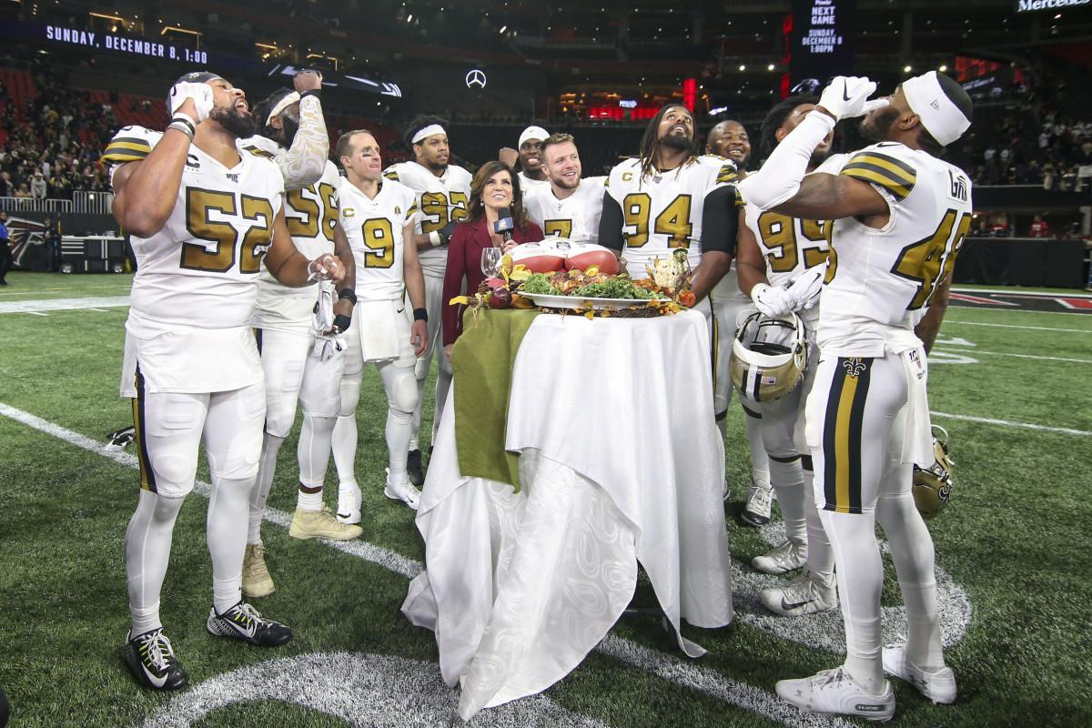 Nov 28, 2019; Atlanta, GA, USA; New Orleans Saints players talk to sideline reporter Michele Tafoya after a game against the Atlanta Falcons at Mercedes-Benz Stadium. Mandatory Credit: Brett Davis-USA TODAY Sports